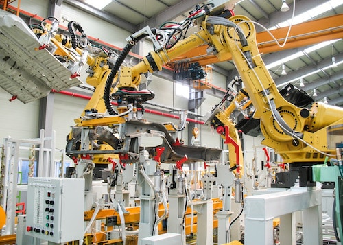 FANUC robots used in a manufacturing plant