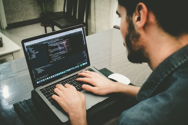 online Master's Degrees in Computer Science are Common. Student working on a computer program